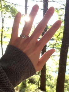 Her beautiful ring shining through the trees.