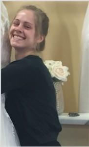 Kathleen Hugging Her Wedding Dress