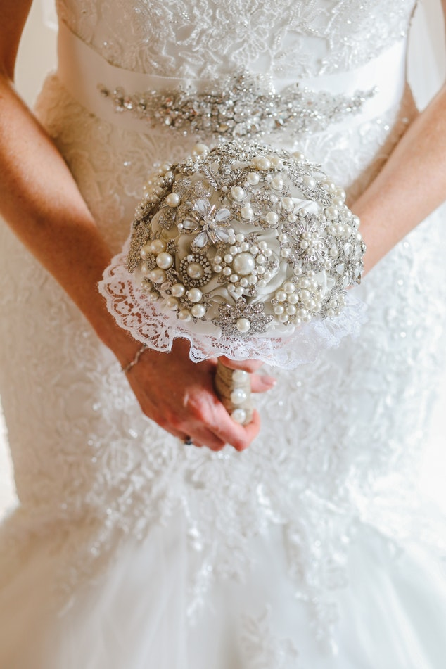 A woman holding her bridal bouquet