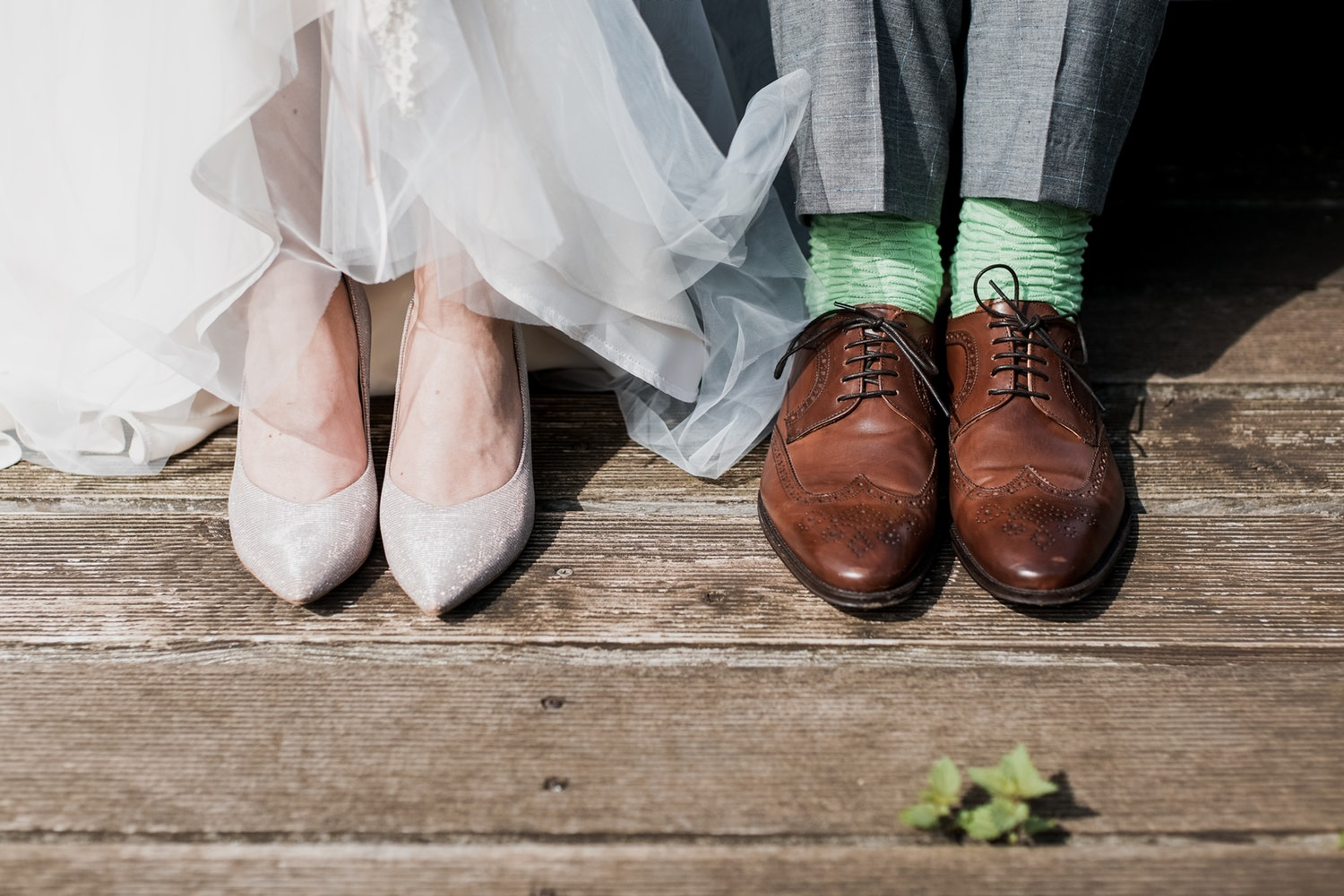 Pairs of men's and women's wedding shoes