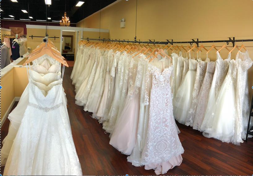 Wedding dresses in rows from Darianna Bridal & Tuxedo's wedding dress gallery