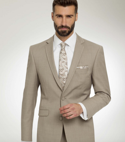 Sand stone color tuxedo with matching floral long tie and pocket square is perfect for the 2022 wedding color trends