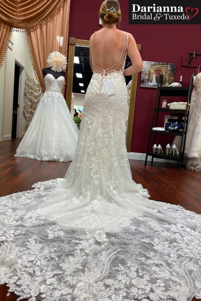Morilee fitted lace dress with open back and beaded straps, cathedral train