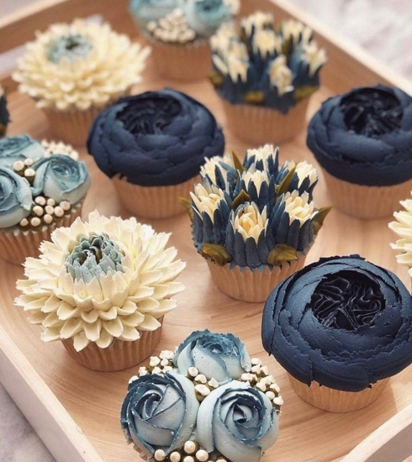 Cupcakes in white and shades of blues decorated as flowers