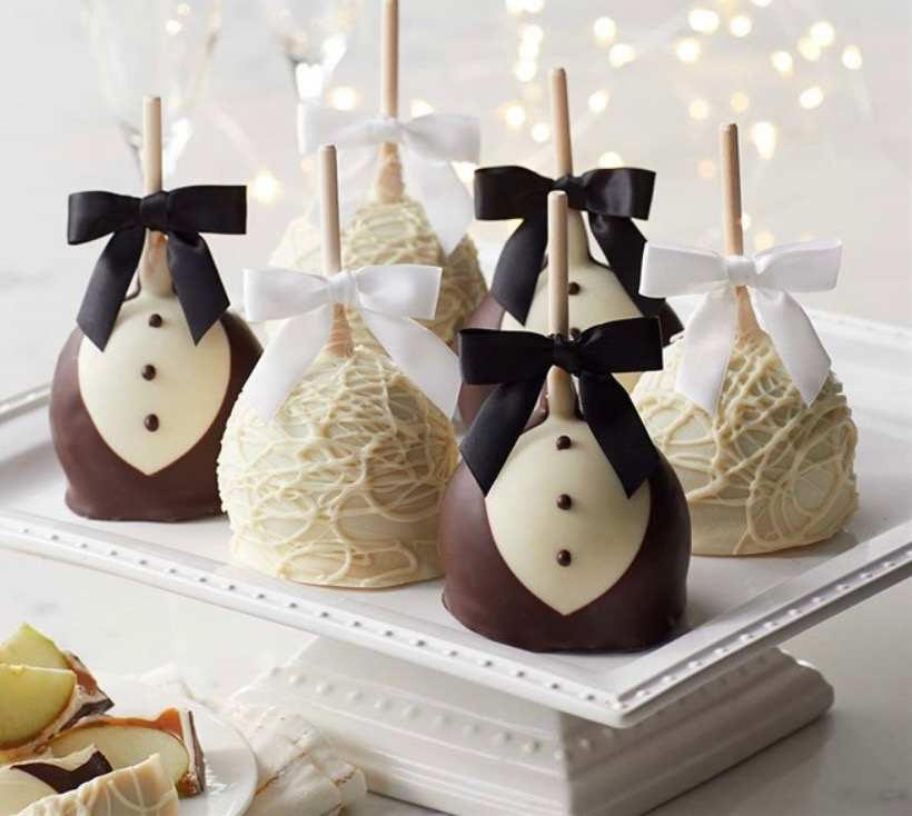 caramel apples decorated as bride's lace and groom's tuxedo