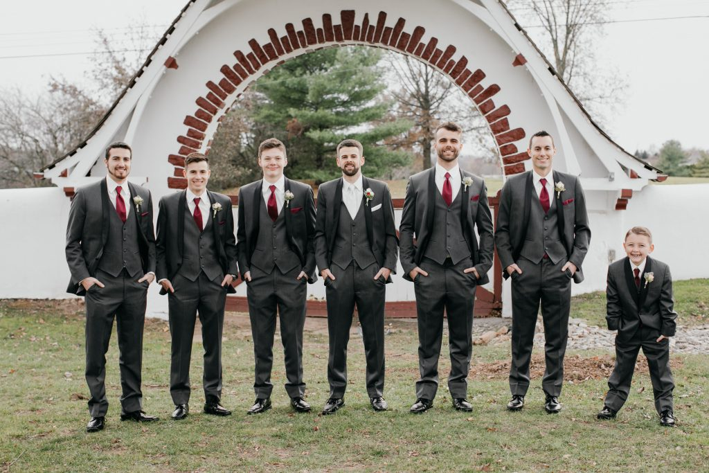Groom with his 5 groomsmen and a junior usher in charcoal tuxedos for the minimony at Cairnwood Estates