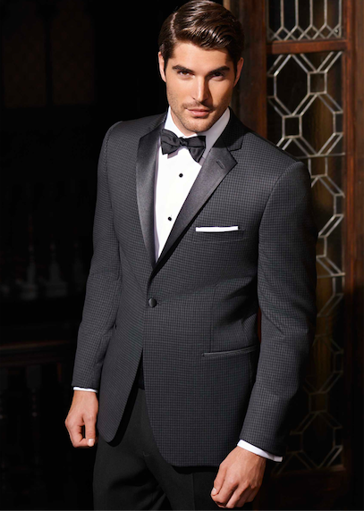 Model in checkered tuxedo jacket with black pants, white shirt and black bow tie, perfect for fathers