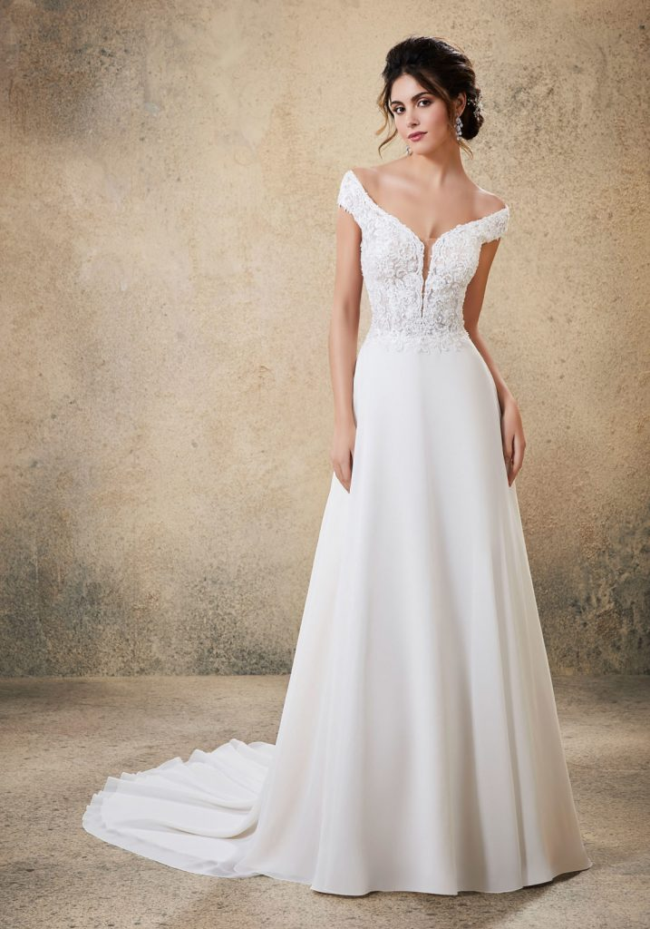 Morilee by Madeline Gardner makes this chiffon fabric wedding dress.  The dress is shown in ivory and is called Raelynn.