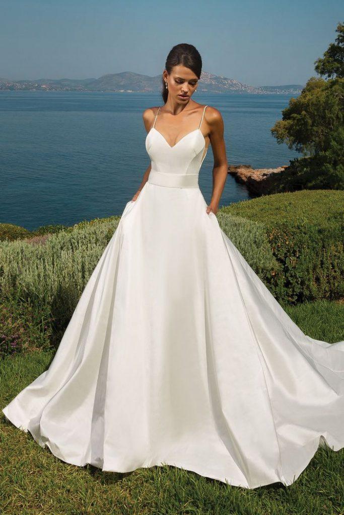 A pure ivory silk dupioni dress made by wedding dress designer Justin Alexander.
