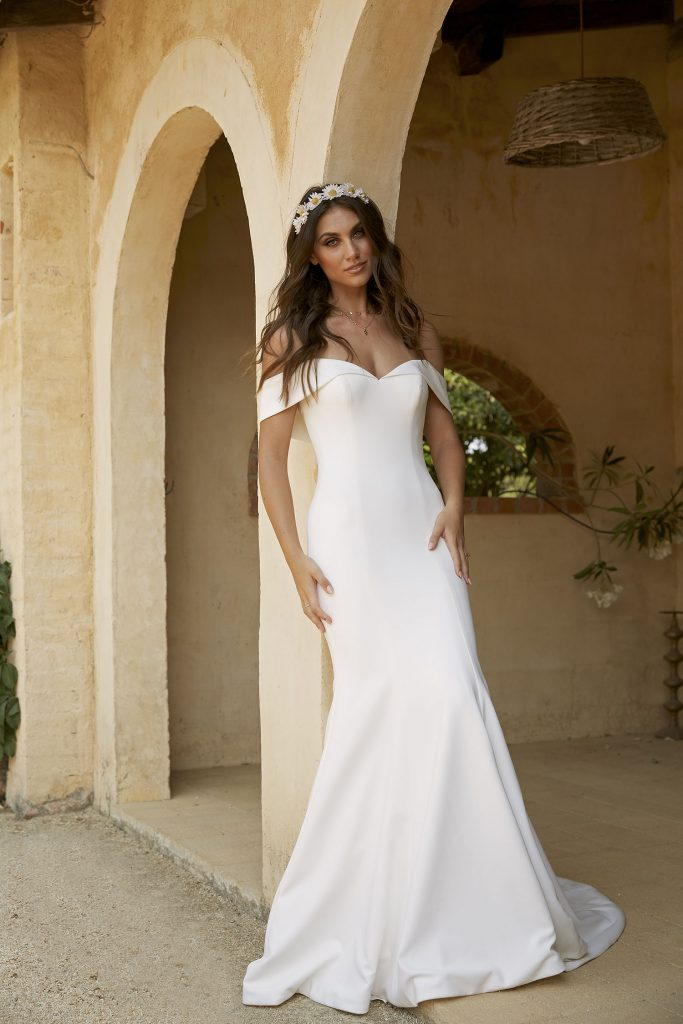 This is a crepe fabric wedding dress is made by Australian wedding dress designer Madi Lane Bridal.  This dress is called Fallon.