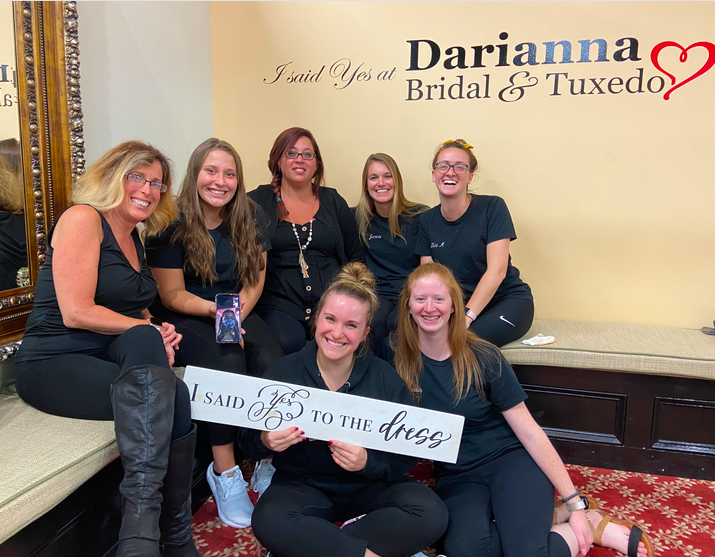 7 of our bridal consultants in our bridal suite