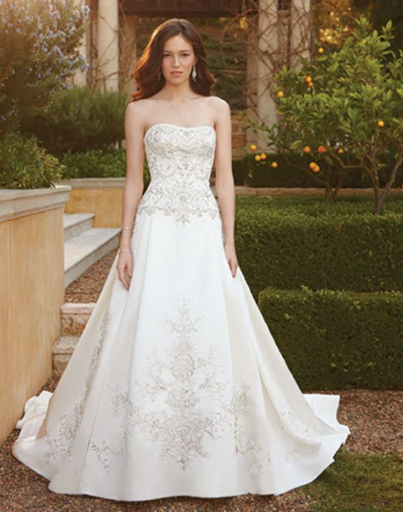 Casablanca Bridal designed and made this wedding dress.  The beautiful ivory dress is made with embellished satin and shows ornate details from the bodice to the train.