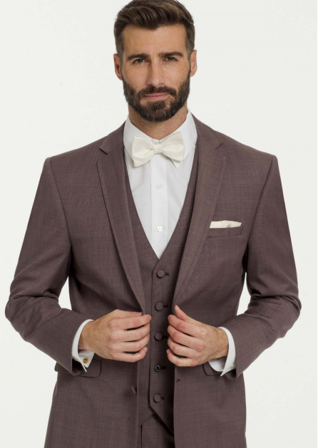 Three-piece suit in the color mulberry with a white bowtie and matching pocket square by Allure Men tops our suit wedding trends this year!