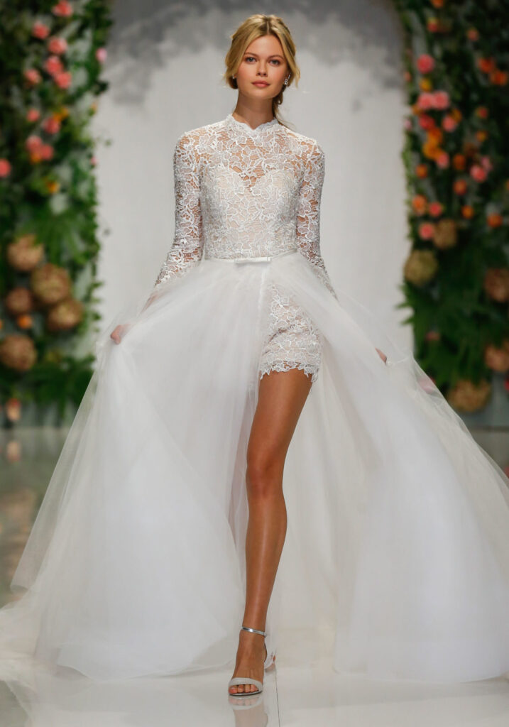 Long sleeve lace top with high illusion neck and a detachable playing ball gown tulle skirt. When we moved, the outfit underneath is a one piece romper!