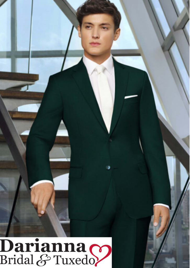 Model in hunter green color suit with long white tie and matching pocket square, perfect for holiday galas