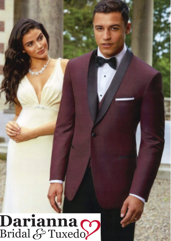 Model in burgundy colored tuxedo with black satin shawl lapel and black pants