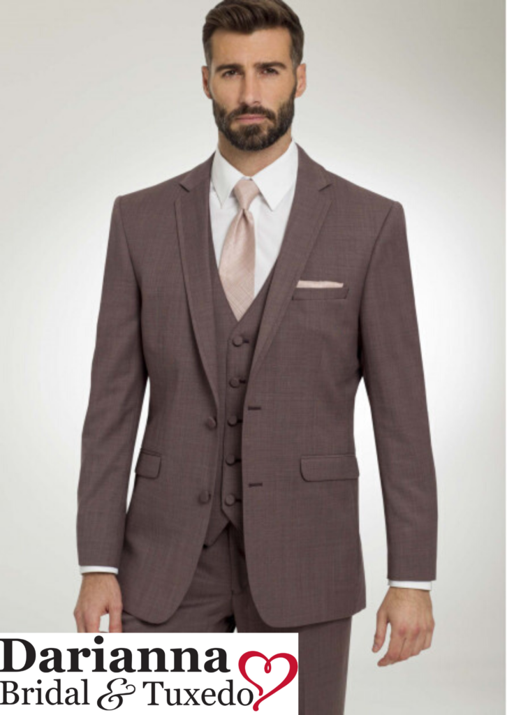Model in Mulberry colored tuxedo with matching vest and pants, long blush color tie, perfect for holiday galas