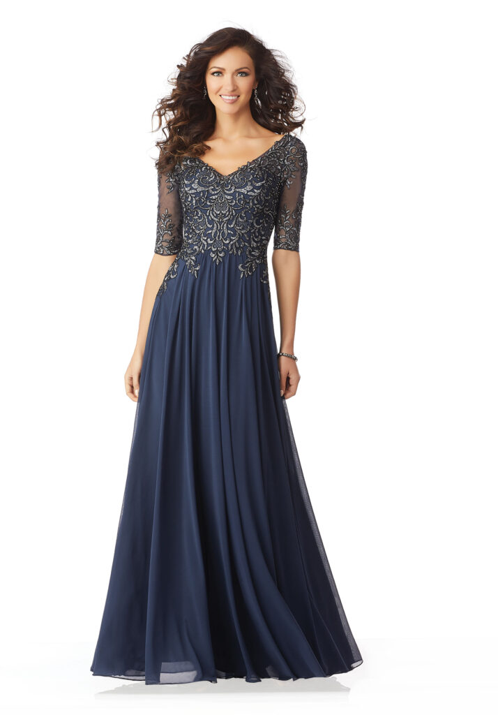 A mothers dress in an A-line shape with a v-neck, three-quarter beaded sleeves in the color navy and fabric chiffon