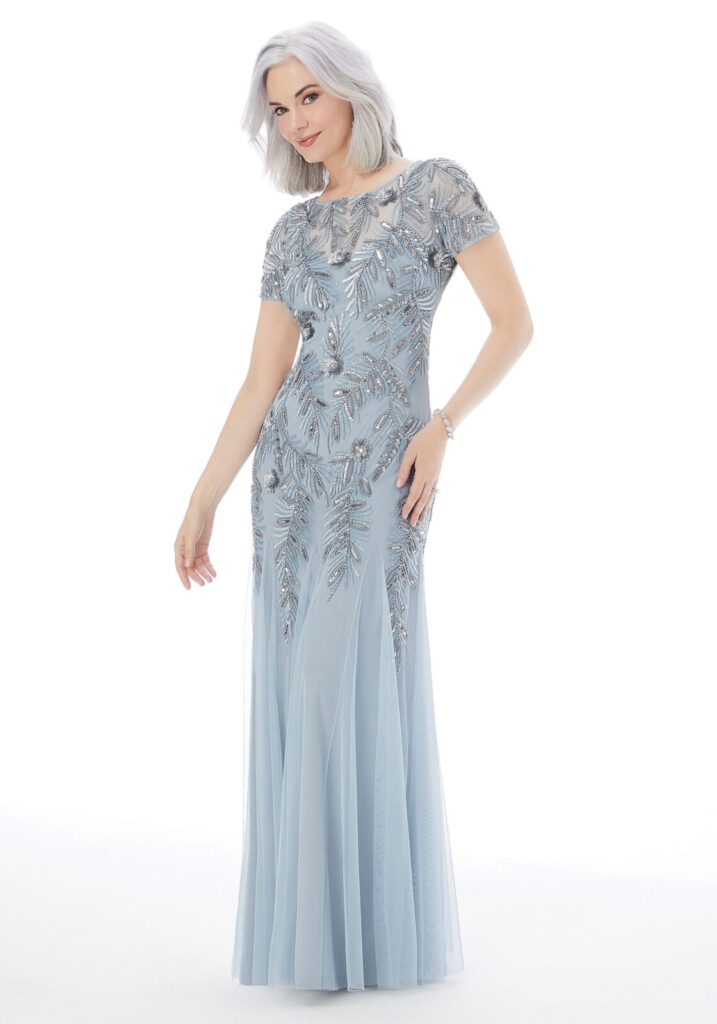 A sheath dress with a beaded bodice, matching beaded short sleeves, and a chiffon skirt in the color cornflower blue