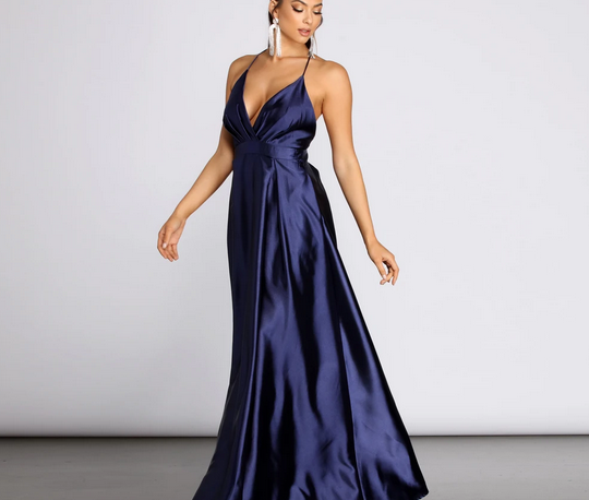 A navy colored full length satin dress with spaghetti straps, V-neck line, and banded waist