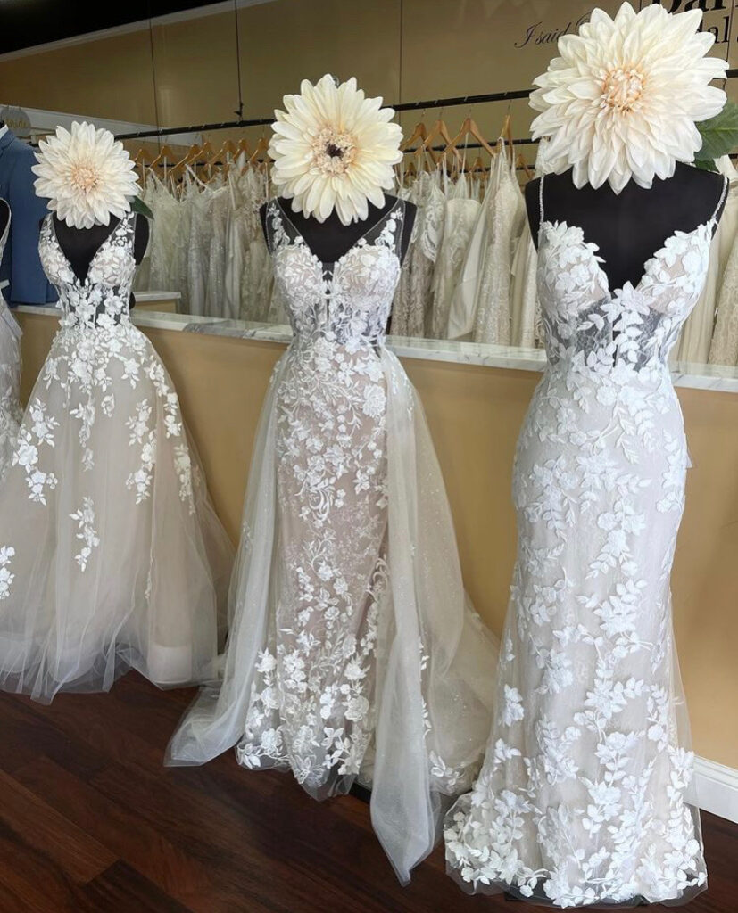 Lace wedding dress has a detachable sparkle and lace train that turns the fitter shape into a ball gown, it is a perfect option for a bride struggling between her top two dresses where one has a full skirt and the other is a sheath
