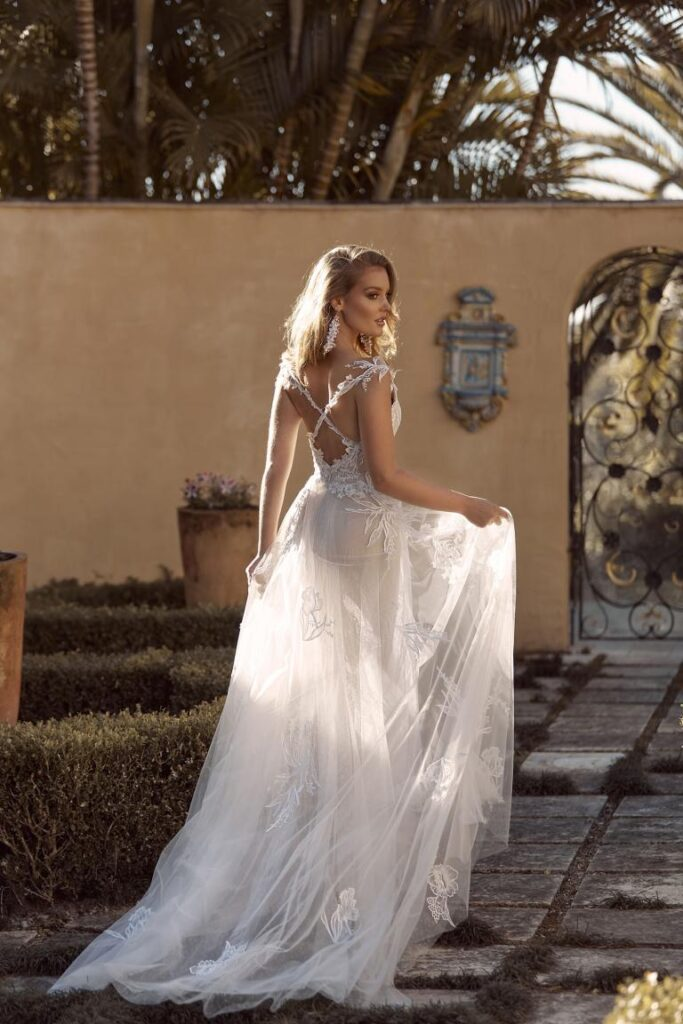 Madi Lane dress Birdie, a pretty a-line with scattered unbeaded lace appliqué, lace vine-like straps leading to a crisscross back