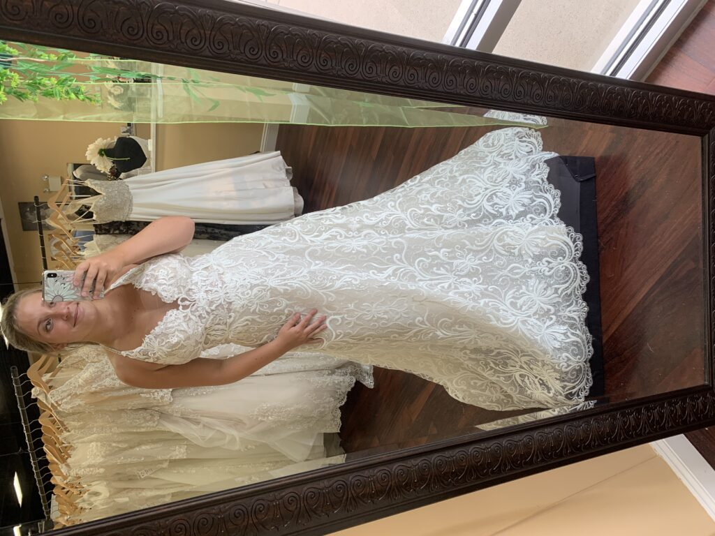 Bride modeling a lovely lace wedding dress with halter neck line, A-line skirt, finish scalloped hem line, perfect for an outdoor or summer wedding, garden wedding, micro wedding, BoHo bride, minimony dress