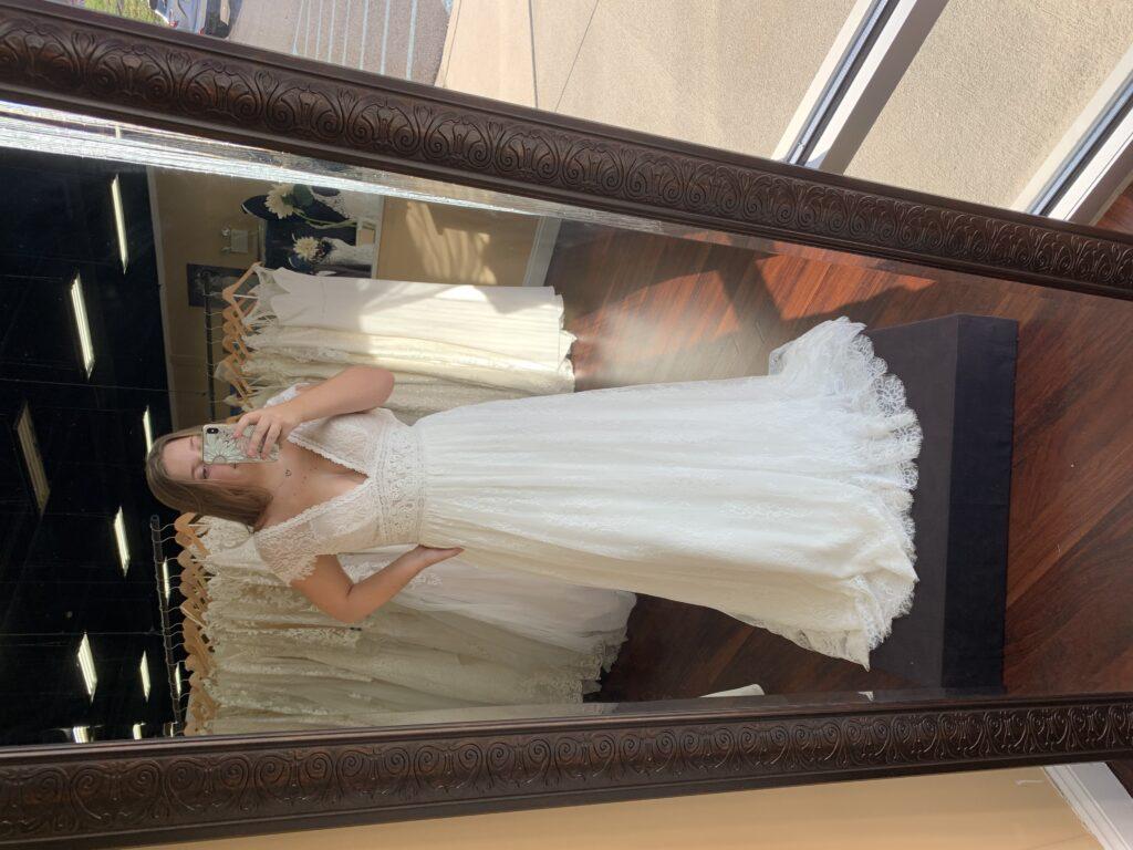 Bride in lace wedding dress, Lillium dress, blue by Enzoani, cap sleeve, banded waste, V neck, BoHo, minimony dress, micro wedding dress
