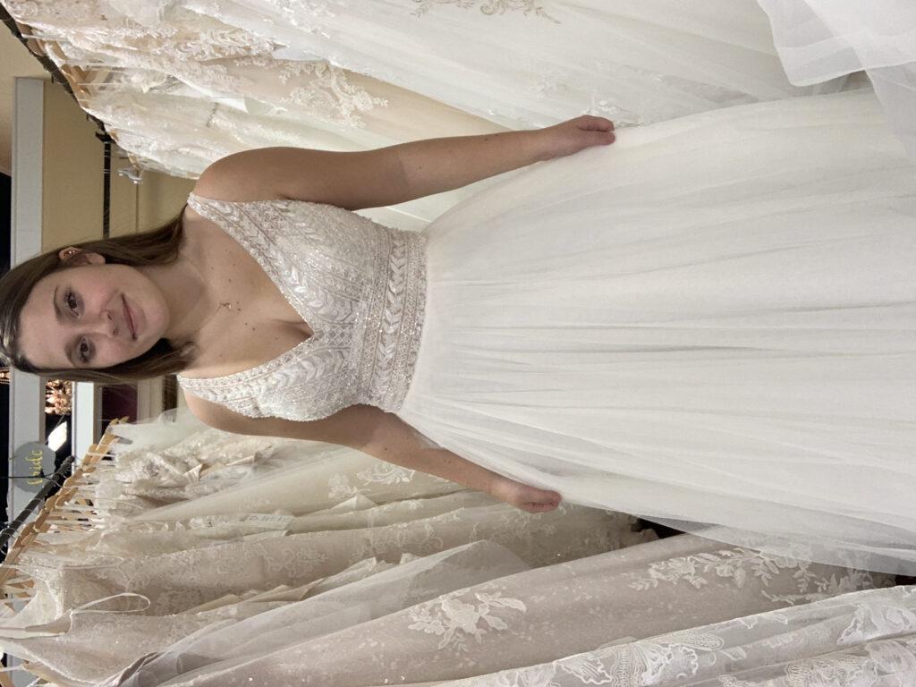 Bride in wedding dress with beaded V- neck bodice, accentuated waist, English net A-line skirt. Micro wedding dress, destination wedding dress, outdoor wedding dress, minimony dress