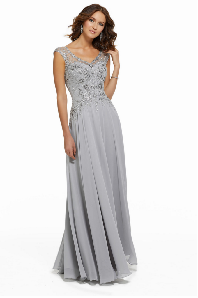 Mother of the bride dress by MGNY designer Madeline Gardner with a beaded V-neck bodice and a chiffon skirt with a slit