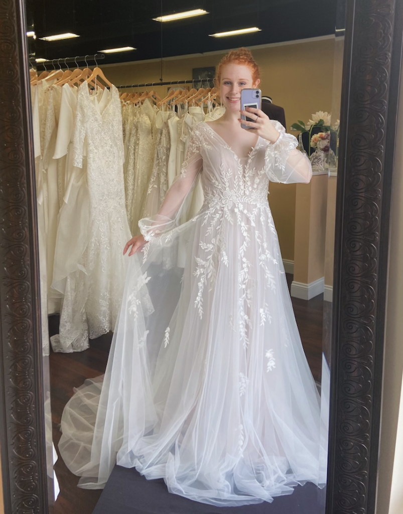 Bea by Madi Lane bridal is a favorite with a sheer and light A-line boho wedding dress with long sleeves and a beautiful vine lace pattern