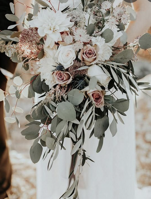 Wedding bouquet with sage green ivory and peach roses