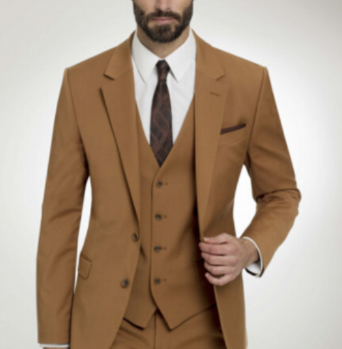 Three piece camel colored suit for fall is a beautiful choice and right in with 2022 wedding trends